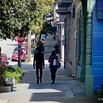 Couple_walking_down_the_street_in_San_Francisco-unknownmami