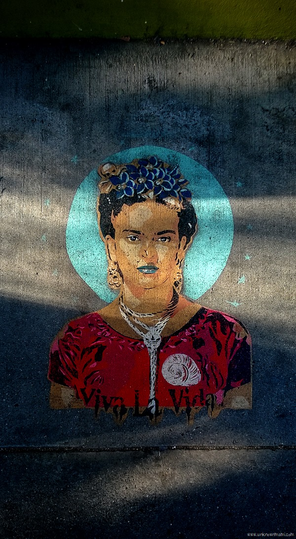 Frida Kahlo on the sidewalk of the Mission