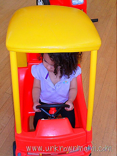 Little girl driving toy car