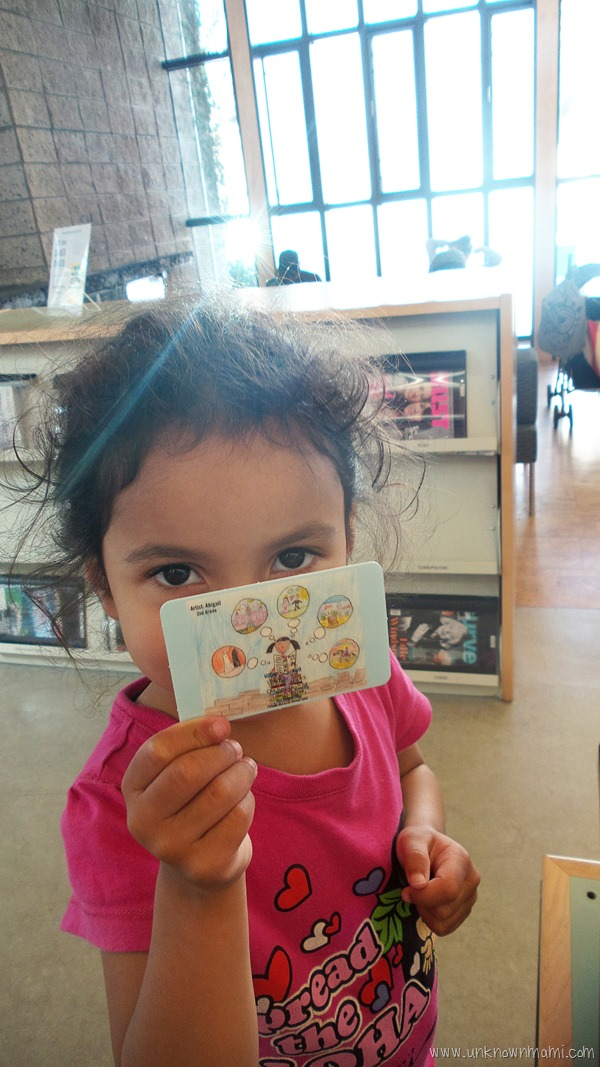Child with first library card