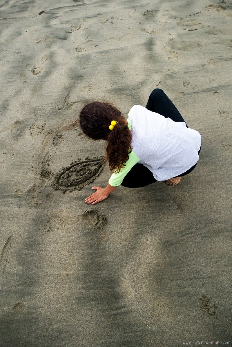 Drawing in the sand at Pacifica State Beach